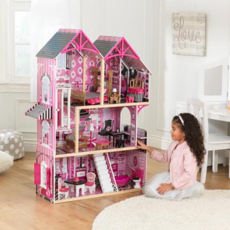 kidkraft casa de muñecas bella 65944 con niña mirándola encantada