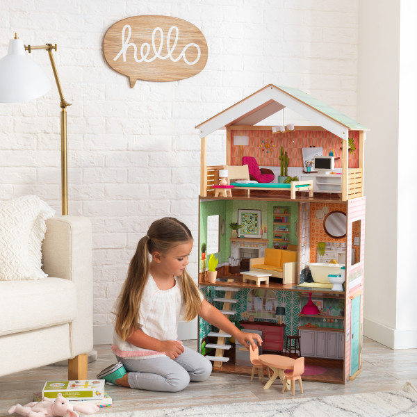 Kidkraft casa dottie 65965 con niña jugando width=