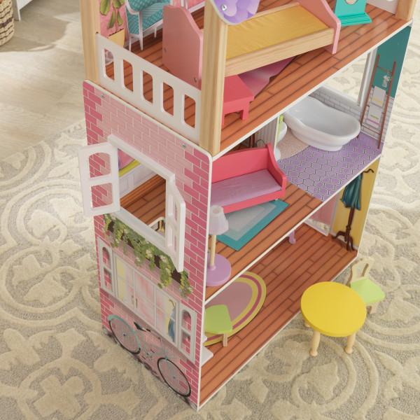 Vista lateral de casa kidkraft de muñecas poppy 65959 donde se aprecia una bicicleta