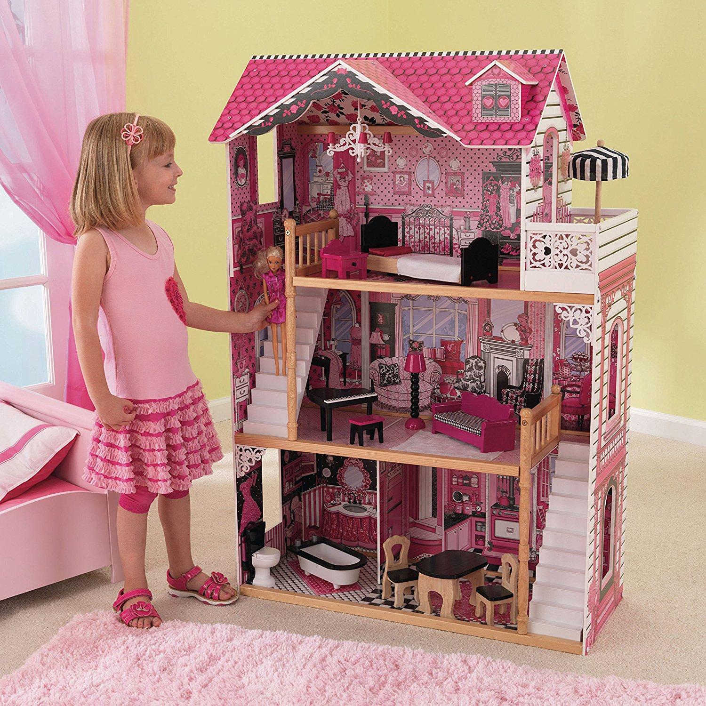 Niña jugando con su kidkraft casa de muñecas 65109 amelia - 2 escaleras width=