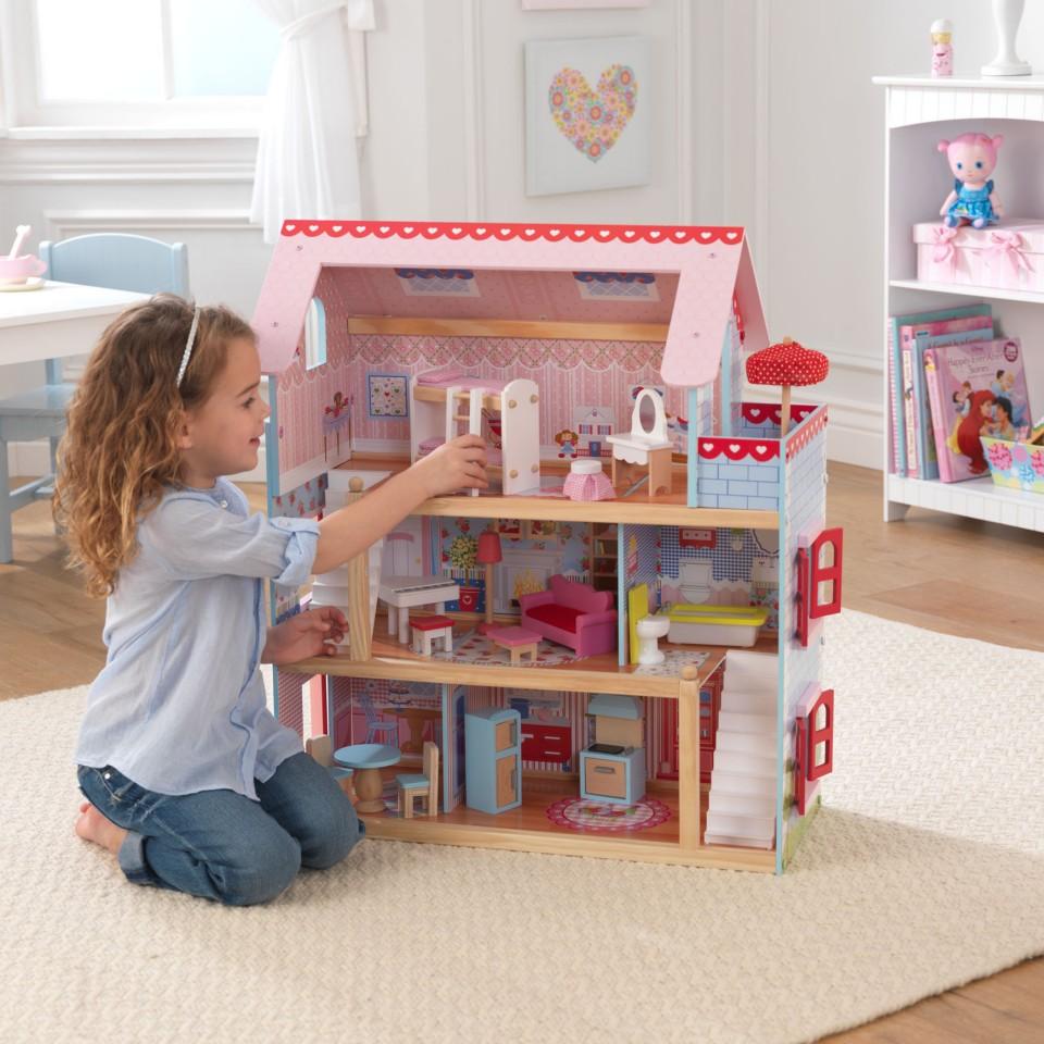 Kidkraft casa de muñEcas Chelsea 65054 con niña jugando en ella
