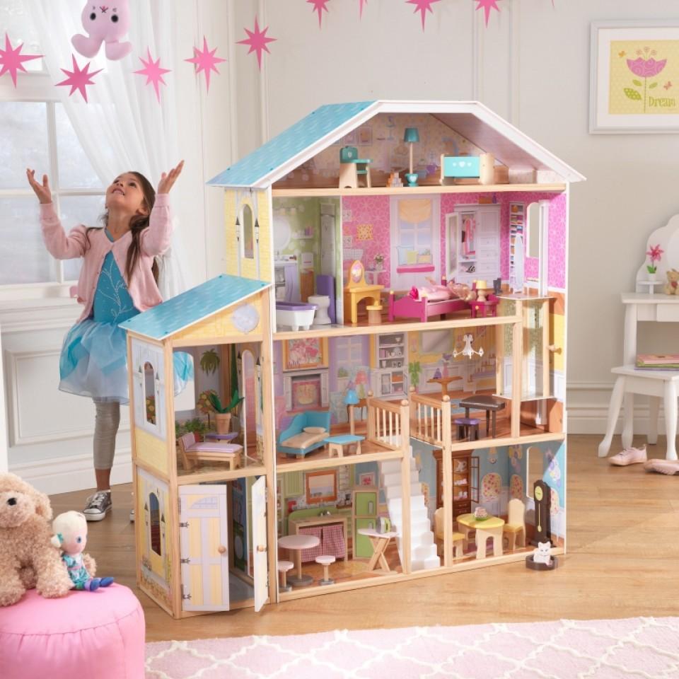 Niña jugando con kidkraft casa de muñecas mansion majestuosa 65252