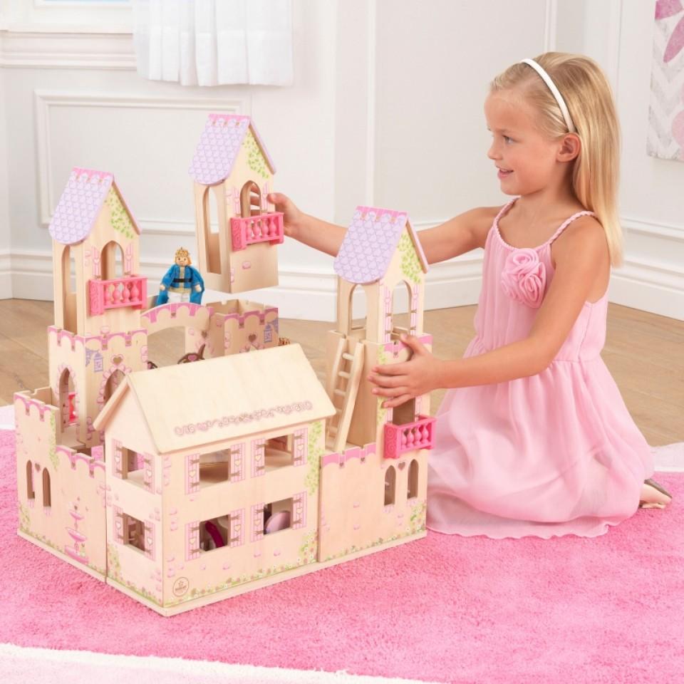 Niña jugando con castillo de princesas 65259 kidkraft width=