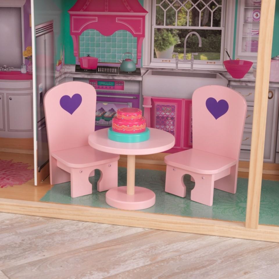 Detalle mesa y sillas de kidkraft elegante mansion para muñecas de 46 cm 65830