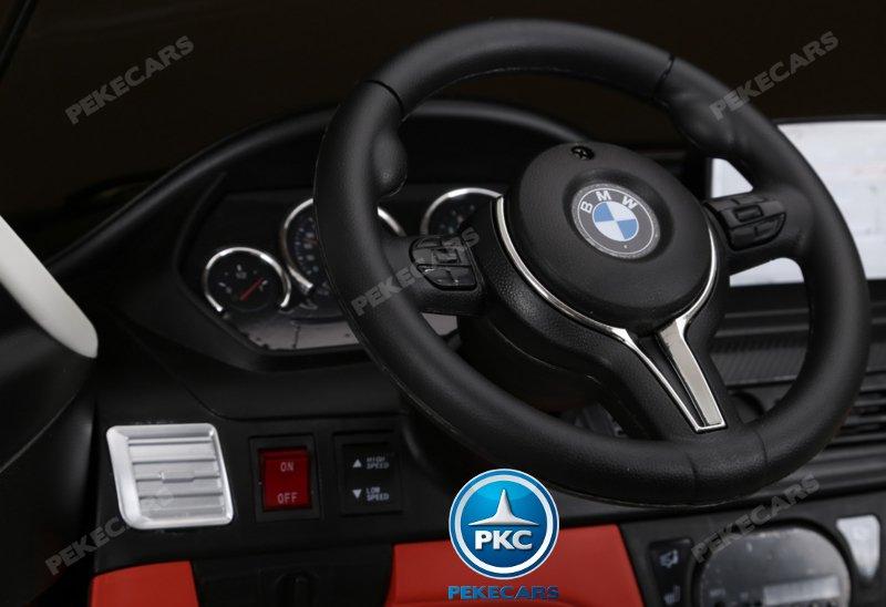 BMW X6 12V 2.4G 2 Plazas color Plata metalizado - Zoom Volante y boton encendido width=