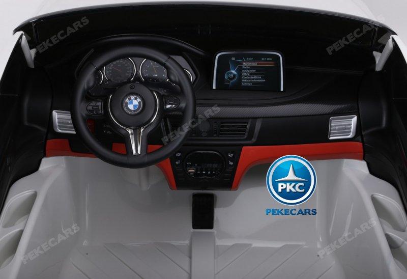 BMW X6 12V 2.4G 2 Plazas color Plata metalizado - Vista Salpicadero y pedal acelerador width=