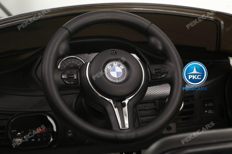 Coche electrico Infantil BMW X6M Negro Metalizado volante