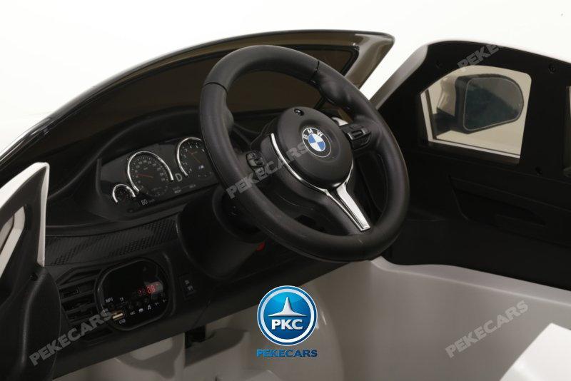 Coche electrico para niños BMW X6M Negro Metalizado detalles del interior