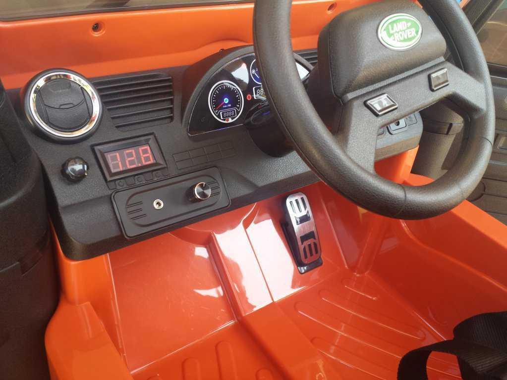 Todoterreno electrico para niños Land Rover Defender Naranja interior delantero