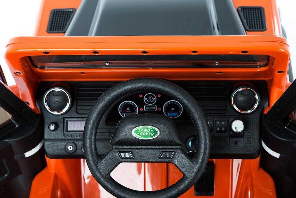 Todoterreno electrico para niños Land Rover Defender Naranja panel