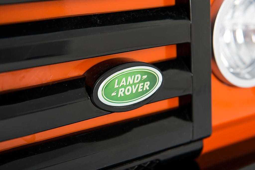 Todoterreno electrico para niños Land Rover Defender Naranja logo