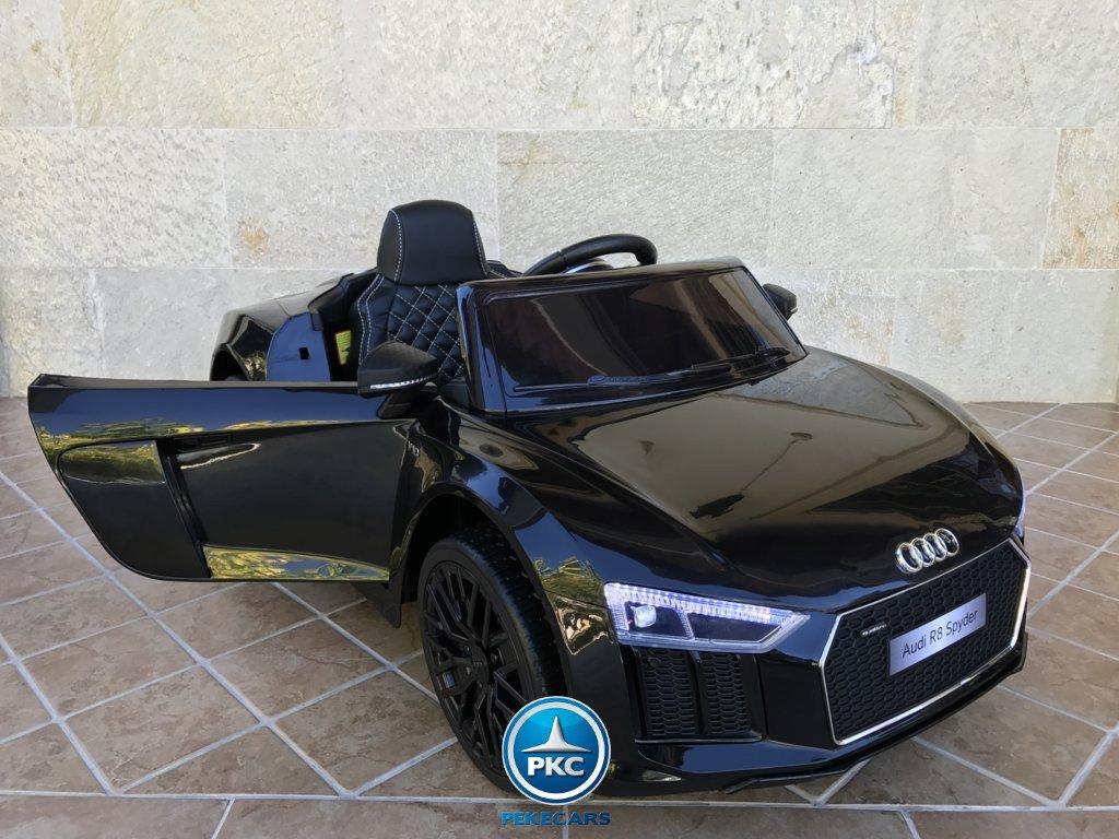 Audi R8 Spider 12v color negro, vista lateral  izquierda con apertura de puerta width=