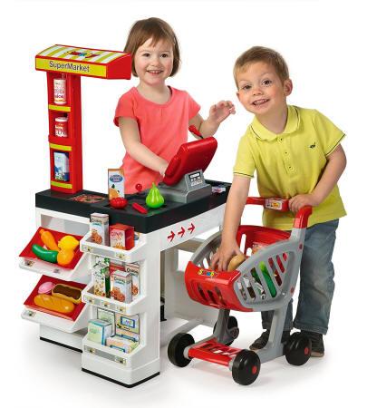 Niños jugando con su Supermercado smoby