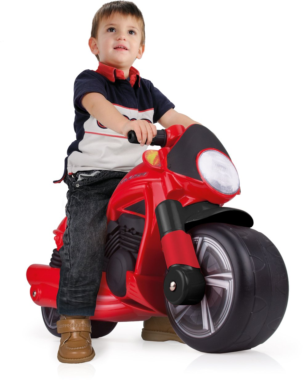 Moto roja compasillos con niño width=