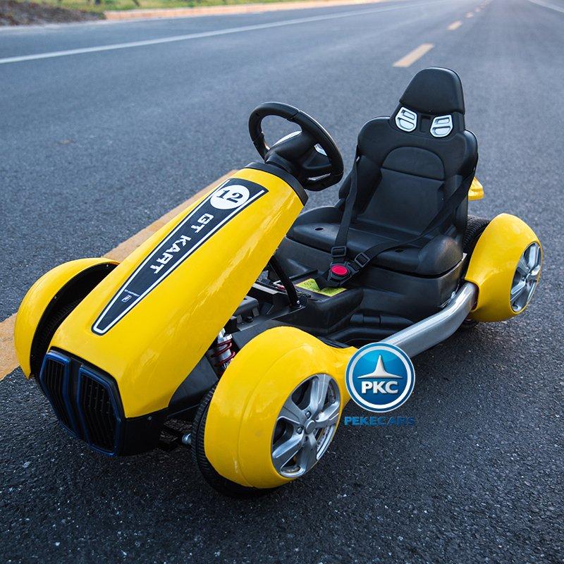 Vista frontal en carretera del pekecars go-kart 12v 2.4g rc amarillo width=