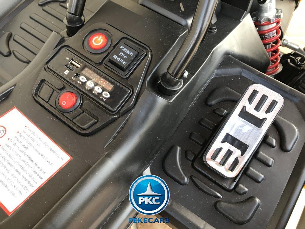 Detalle del acelerador y botón encendido y accesorios del pekecars go-kart 12v 2.4g rc amarillo width=