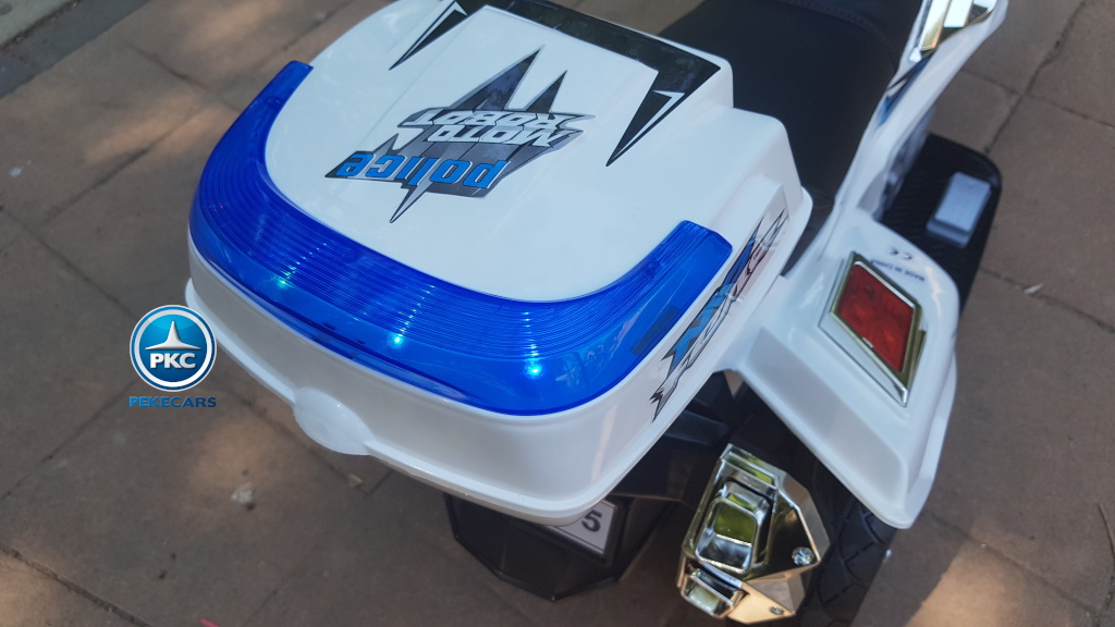 Moto electrica para niños de policia blanca