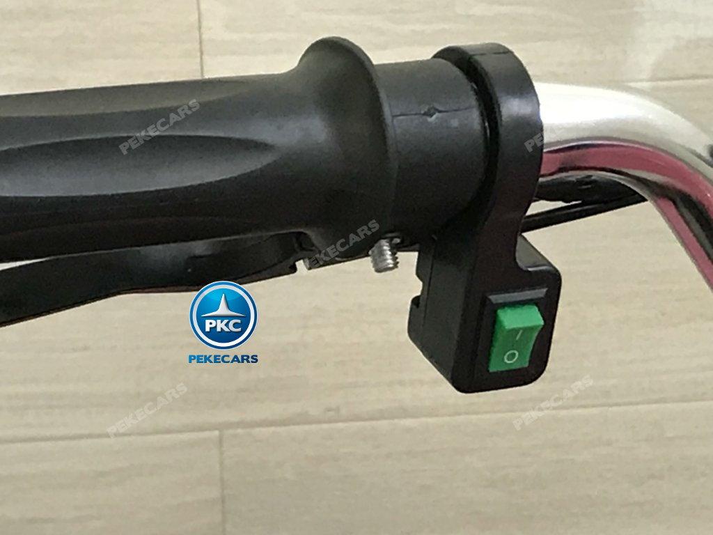 QUAD ELÉCTRICO COBRA 800W 36V ROSA - Boton de encendido de las luces