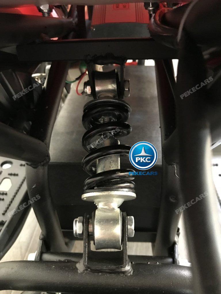 QUAD ELÉCTRICO COBRA 800W 36V ROSA - Zoom amortiguador