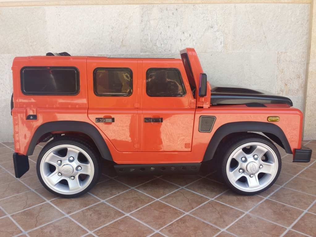 LAND ROVER DEFENDER NARANJA LATERAL DERECHO width=