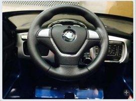 GT deportivo azul metalizado volante width=