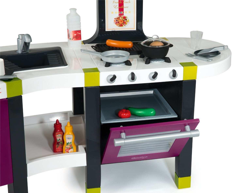 Imagen de la cocina con el horno abierto width=